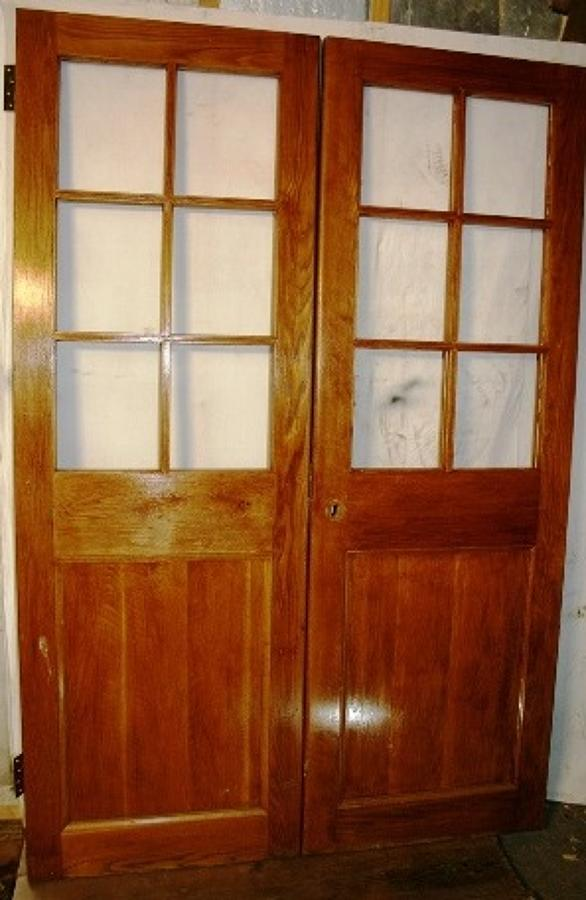 DP0224 A Pair of Edwardian Oak Doors for Glazing