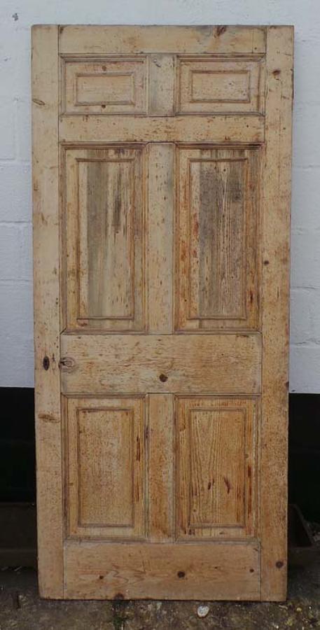 DB0408 A SUBSTANTIAL GEORGIAN PINE PANELLED DOOR