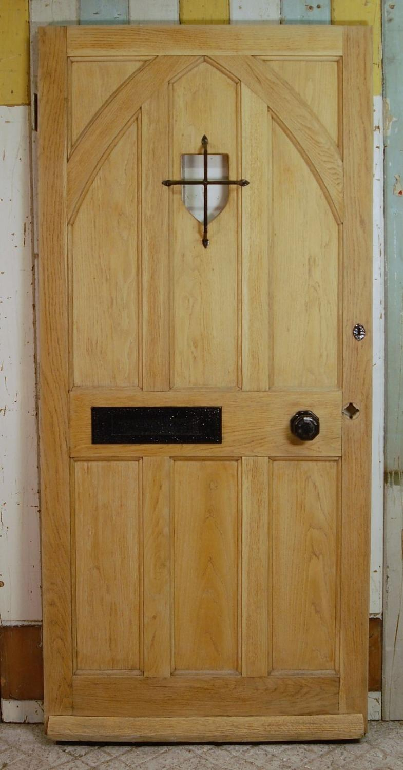 DE0722 A Tudor Style, Oak Front Door with Panel for Glazing
