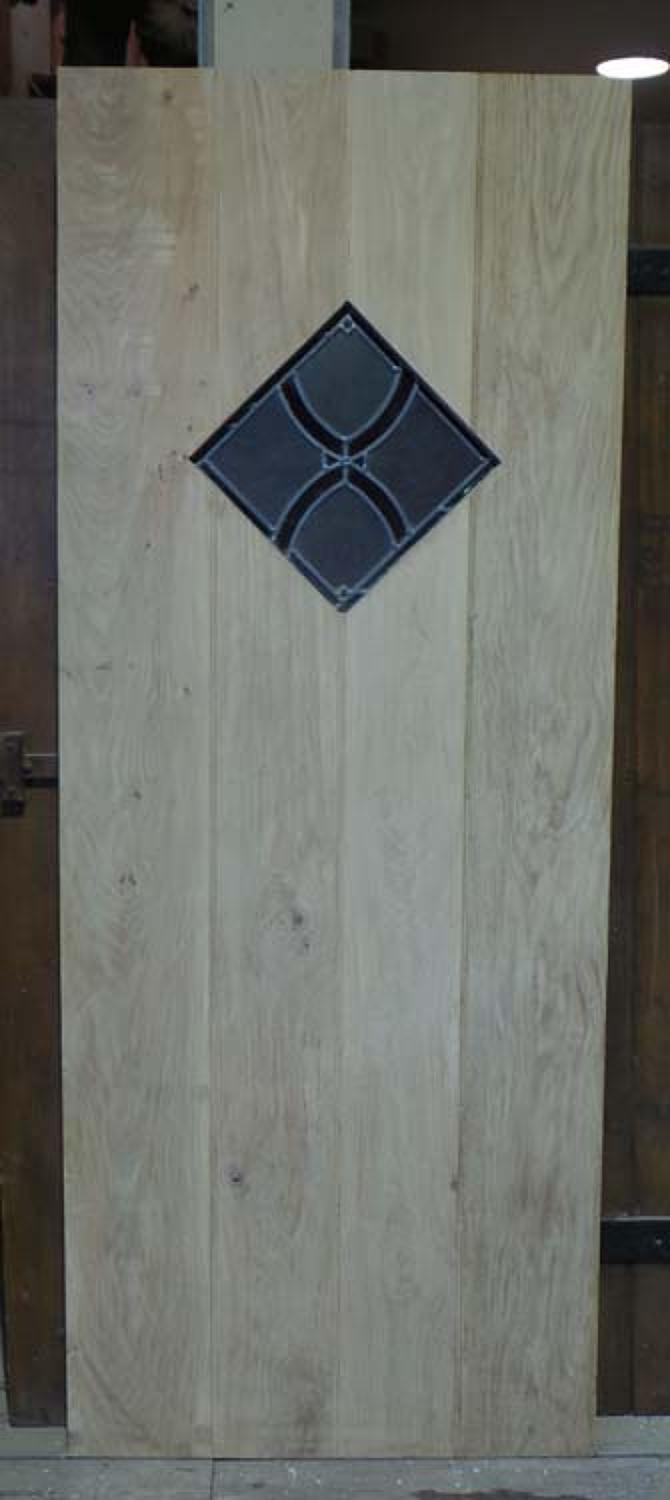 DI0575 STUNNING SOLID OAK LEDGED, PLANKED STAINED GLASS DOOR