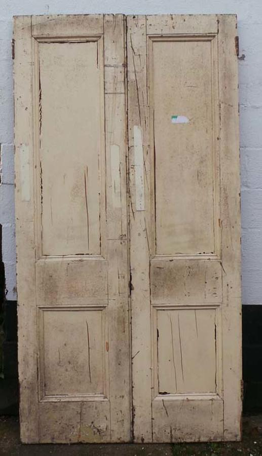 DP0182 A PAIR OF TALL VICTORIAN PINE DOORS FROM ST. PANCRAS STATION
