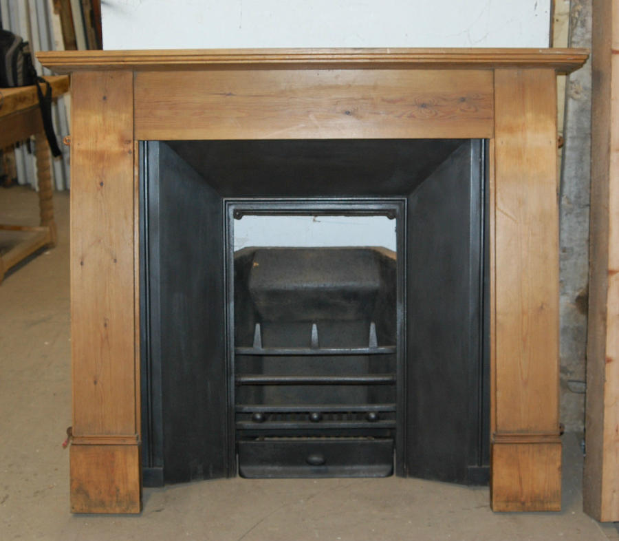 FS0022 Interesting Antique Cast Iron Fire Insert and Pine Fire Surroun