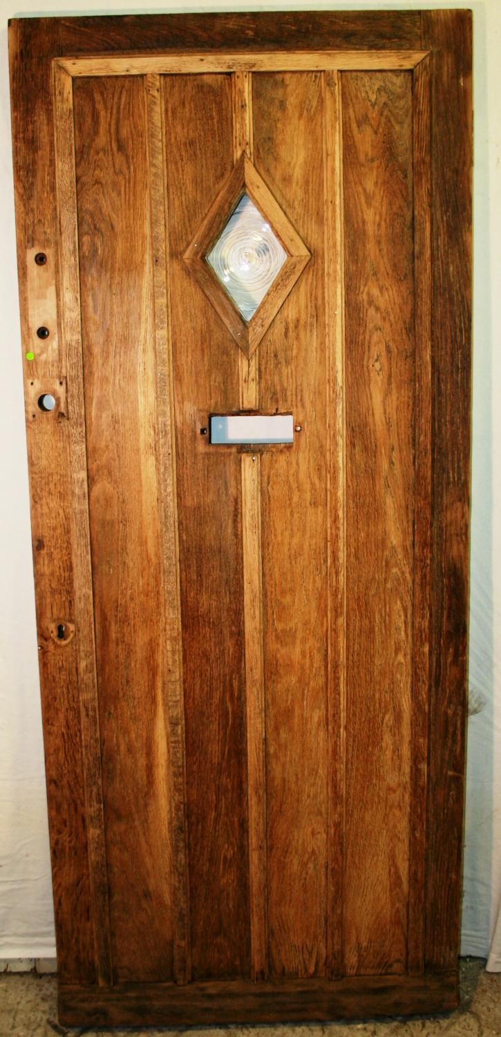DE0733 A Reclaimed Oak Panelled Front Door with Glazed Panel