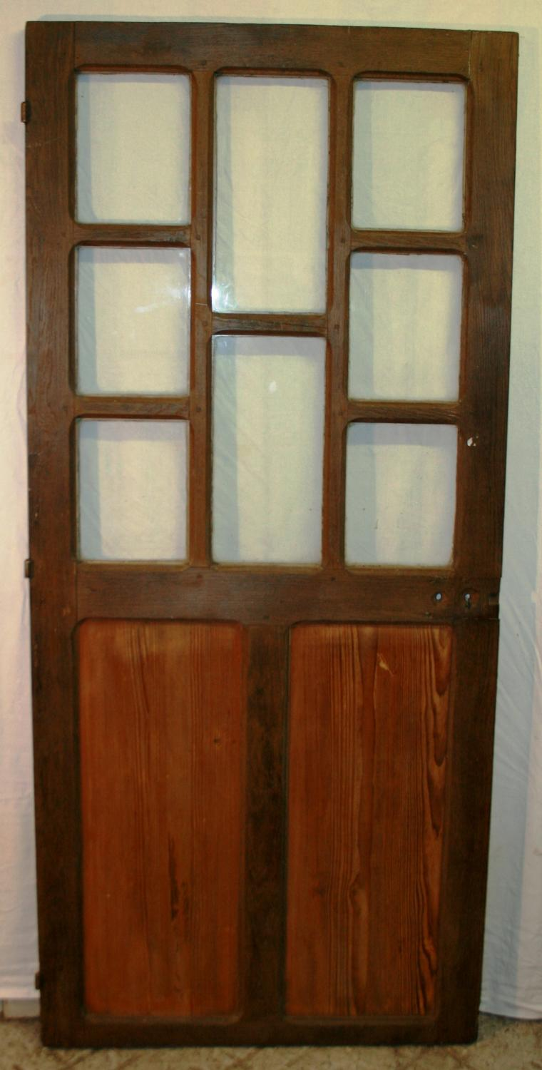 DI0644 A French Oak Door with Pine Panels And Perspex Glazing