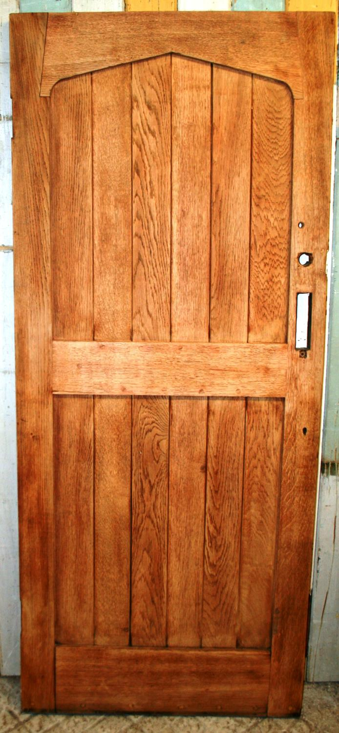 DE0746 An Oak Cottage Door with 6 Panels topped by an Arched Header