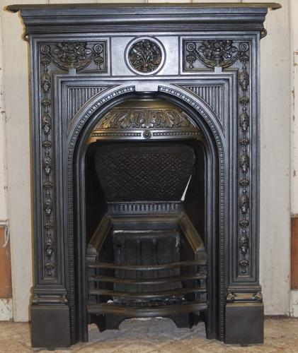 An attractive decorative cast iron Victorian combination bedroom fire