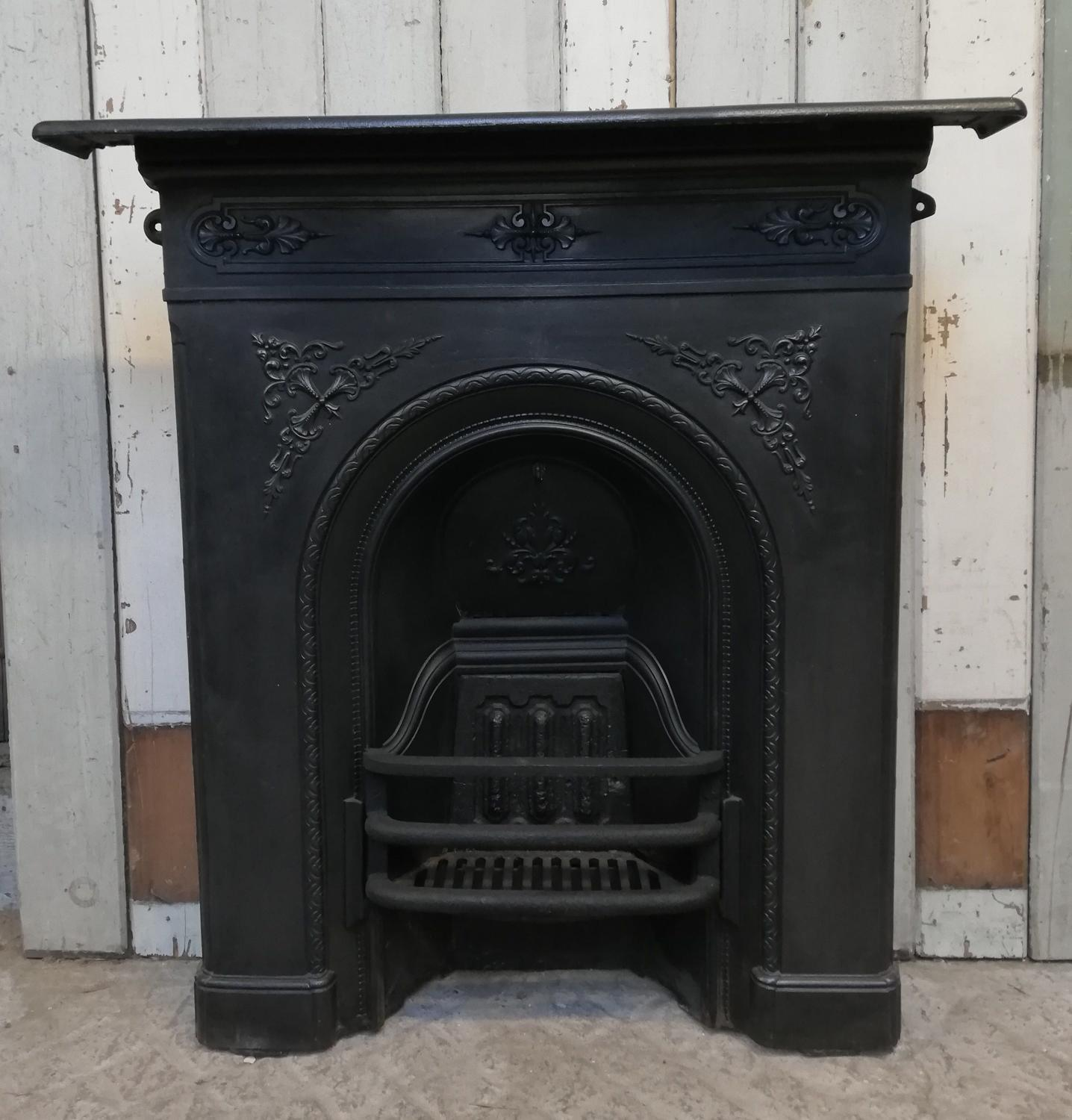 An attractive decorative cast iron Victorian combination fire