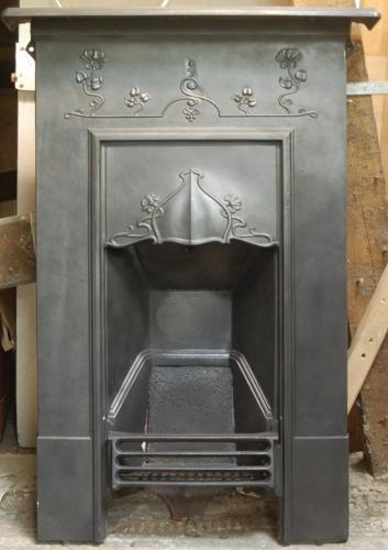 An attractive Art Nouveau cast iron combination bedroom fire