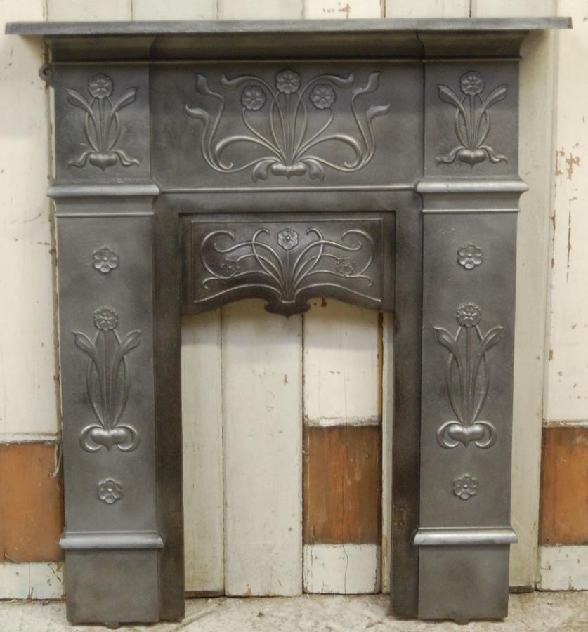 A pretty antique original Art Nouveau cast iron bedroom fire surround