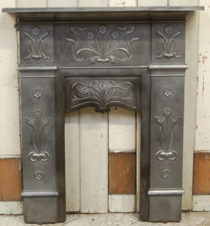 A pretty antique original Art Nouveau cast iron bedroom fire surround