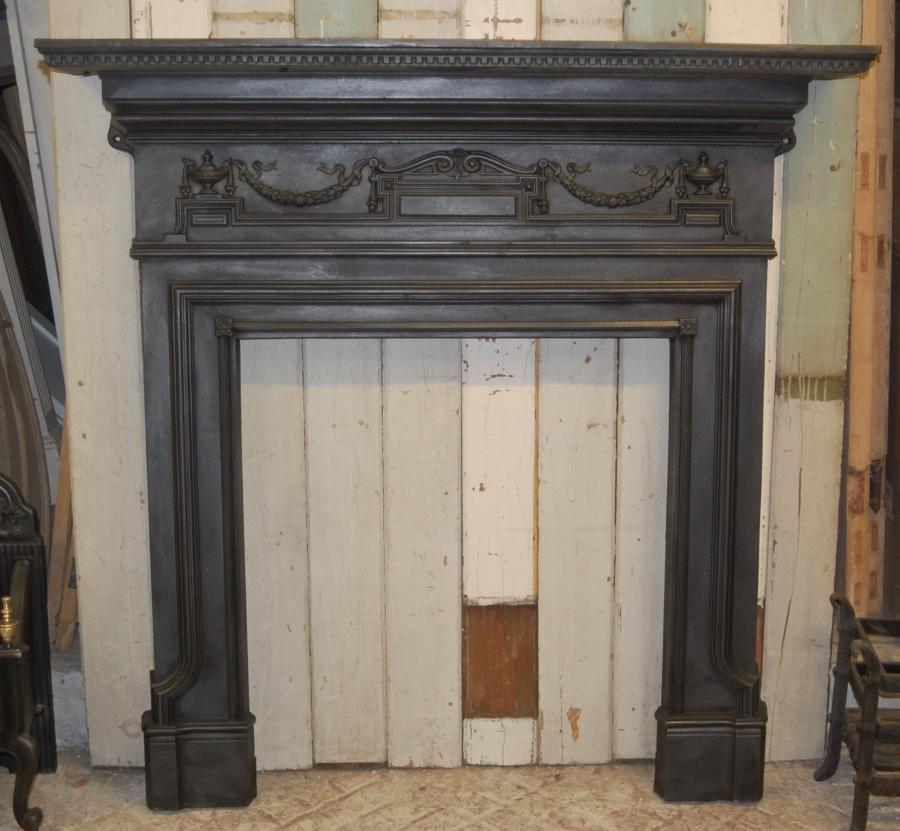 A large rare original Victorian cast iron fire / woodburner surround
