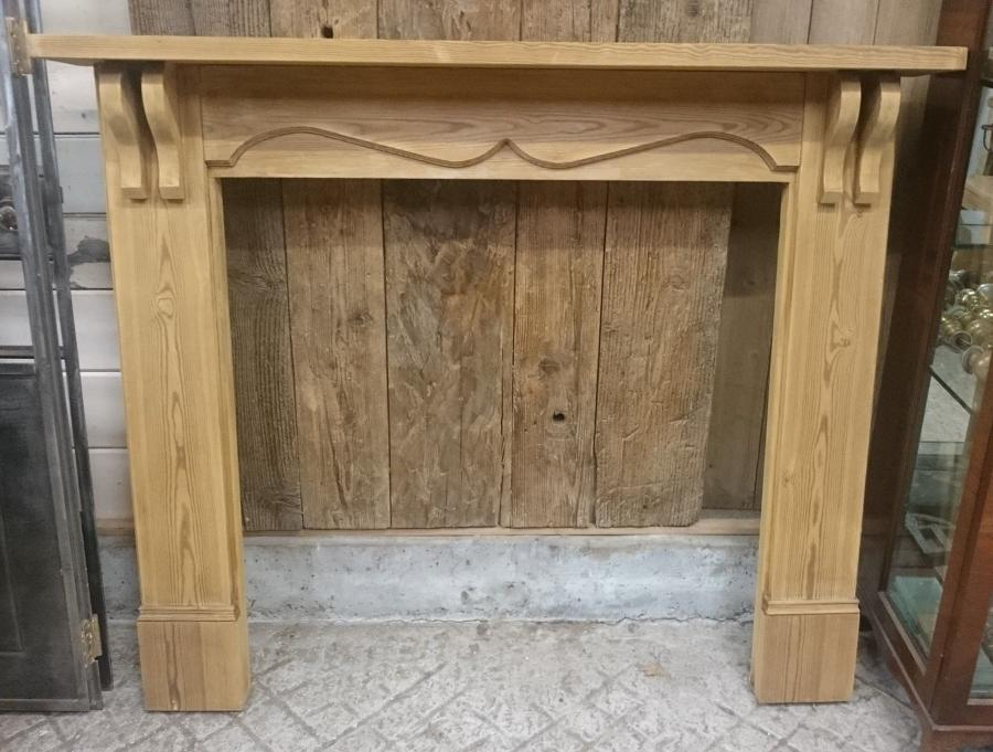 A reclaimed pine fire surround with Edwardian style design