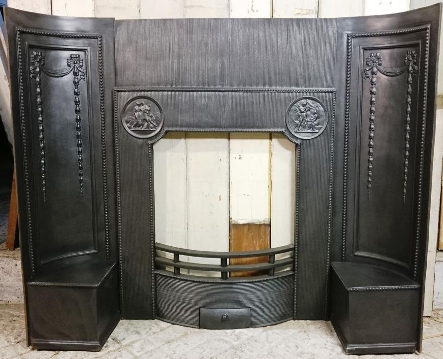 A Georgian or Neo-Georgian Cast Iron Fire Front and Decorative Cheeks