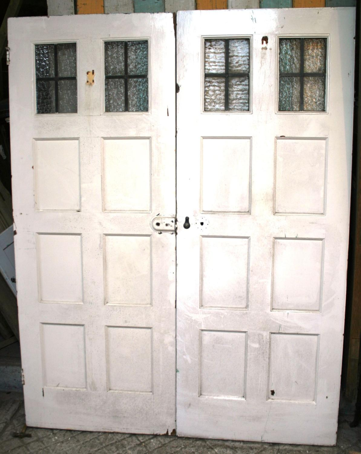 DP0240 A Pair of 8 Panel Edwardian Pine Doors with Leaded Lights