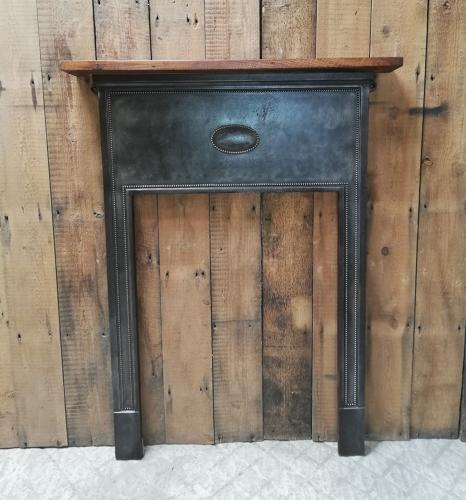FS0042 ANTIQUE CAST IRON FIRE SURROUND WITH CHESTNUT MANTEL C.1920's