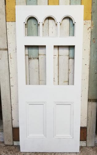DE0774 A BEAUTIFUL VICTORIAN FRONT DOOR WITH ARCHED PANELS FOR GLAZING