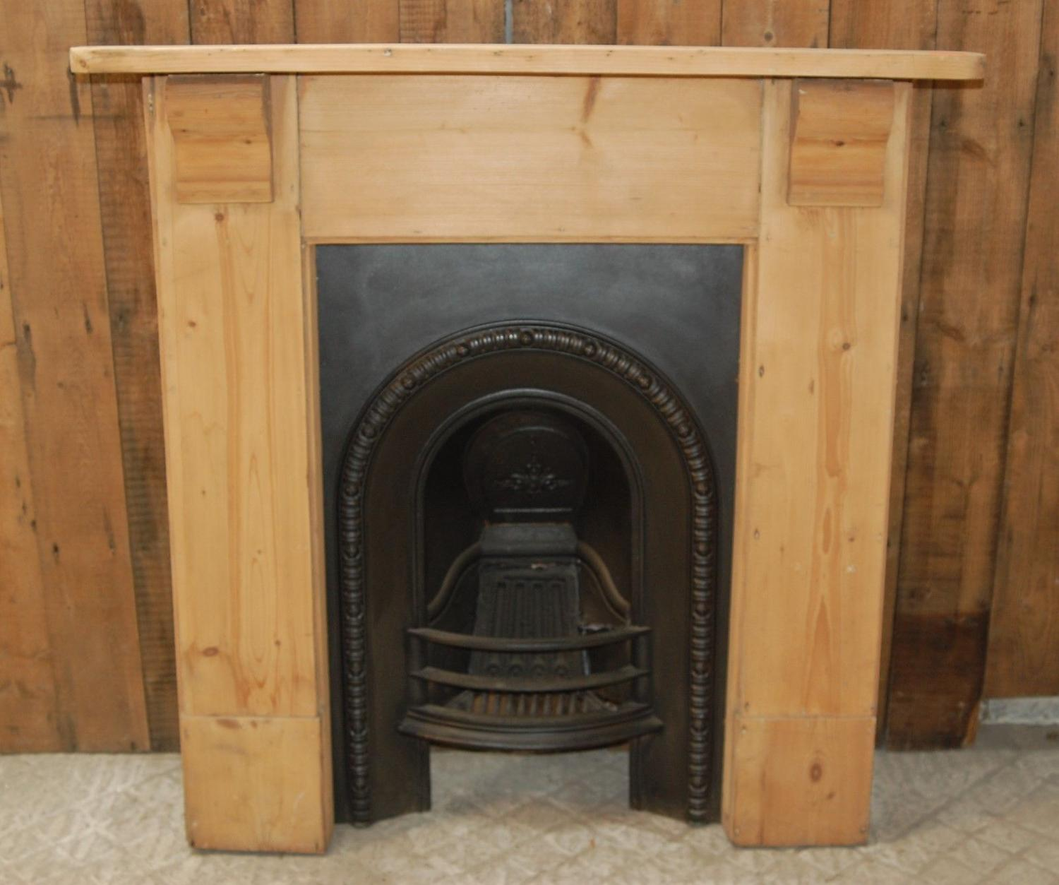 FS0039 AN ANTIQUE PINE FIRE SURROUND WITH VICTORIAN CAST IRON INSERT