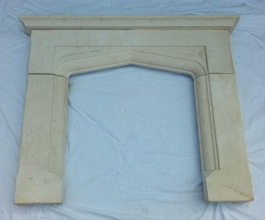 FS0034 A RECLAIMED GOTHIC STYLE CARVED STONE FIRE SURROUND