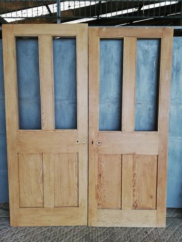 DP0248 A PAIR OF VICTORIAN PINE INTERNAL FOUR PANEL DOORS