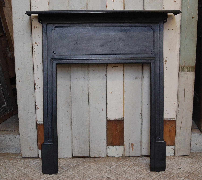 FS0046 AN EDWARDIAN CAST IRON FIRE SURROUND FOR WOOD BURNER OR BASKET