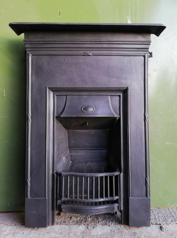 FC0041 A SMALL EDWARDIAN CAST IRON COMBINATION BEDROOM FIRE