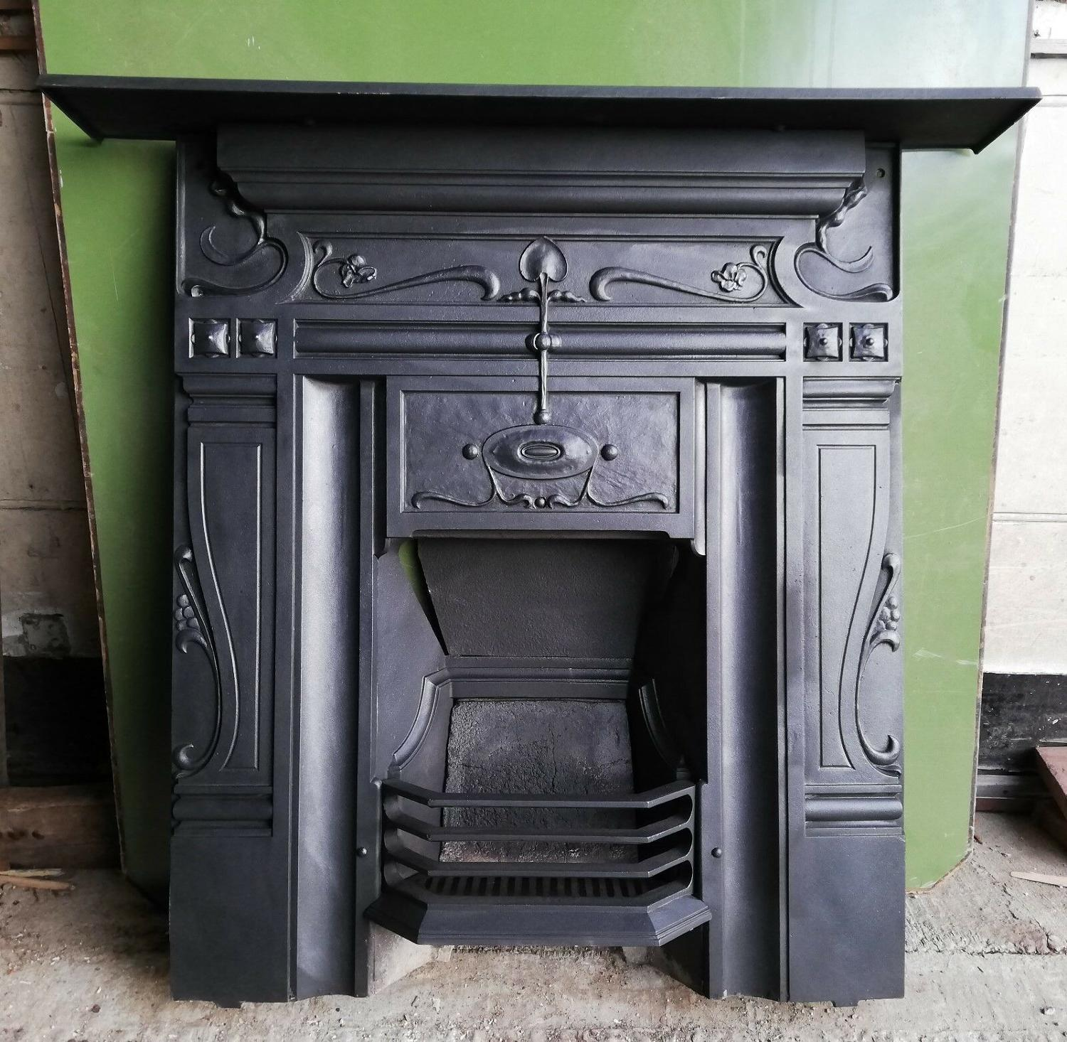 FC0044 AN ART NOUVEAU CAST IRON COMBINATION FIRE