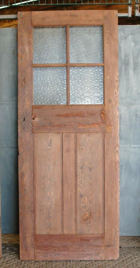 DB0654 AN ANTIQUE RECLAIMED PINE DOOR WITH GLAZING
