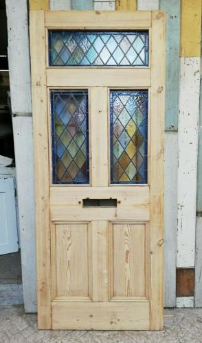 DE0797 A PRETTY RECLAIMED FIVE PANEL PINE AND STAINED GLASS DOOR