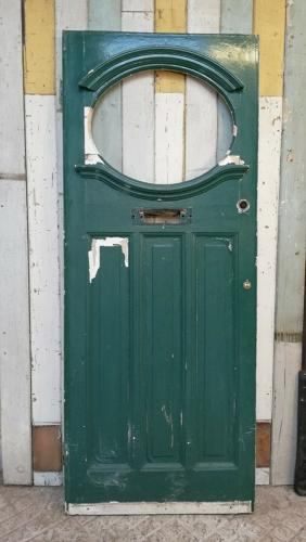DE0799 AN EDWARDIAN PINE FRONT DOOR WITH PANEL FOR GLAZING
