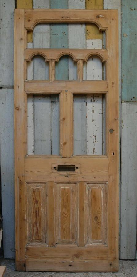 DE0802 A BEAUTIFUL VICTORIAN FRONT DOOR WITH ARCHED PANELS FOR GLAZING