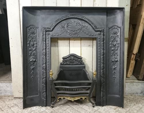 1077 EDWARDIAN CAST IRON FIRE FRONT WITH CURVED FIRE CHEEKS