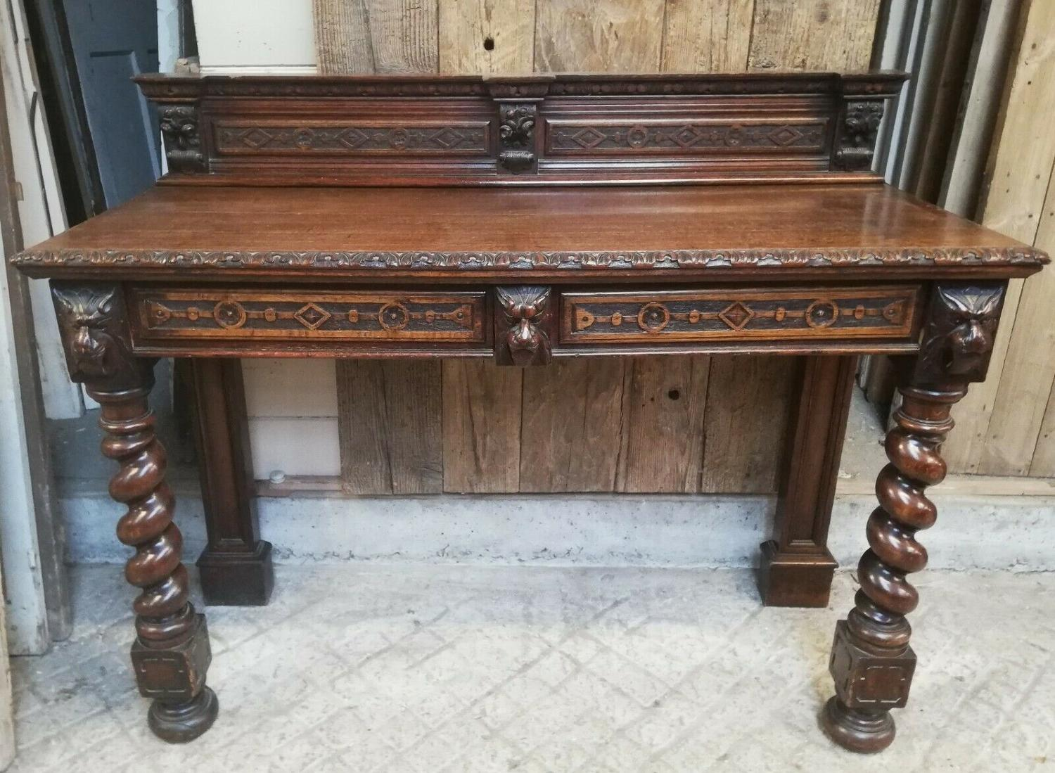 M1273 A CARVED VICTORIAN OAK SIDEBOARD BY EDWARDS AND ROBERTS