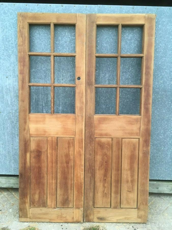 A PAIR OF SOLID HARDWOOD ANTIQUE VICTORIAN INTERNAL SCHOOL DOORS