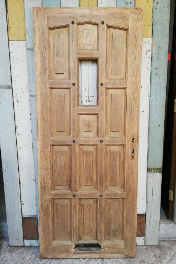 DE0808 A RECLAIMED BARE OAK FRONT DOOR WITH PANEL FOR GLAZING