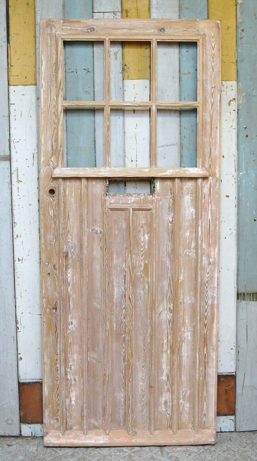 DE0810 A RECLAIMED PINE COTTAGE FRONT DOOR WITH PANELS FOR GLAZING