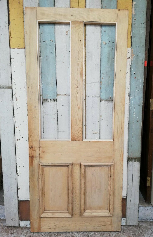 DB0658 A VICTORIAN STRIPPED PINE INTERNAL / EXTERNAL DOOR