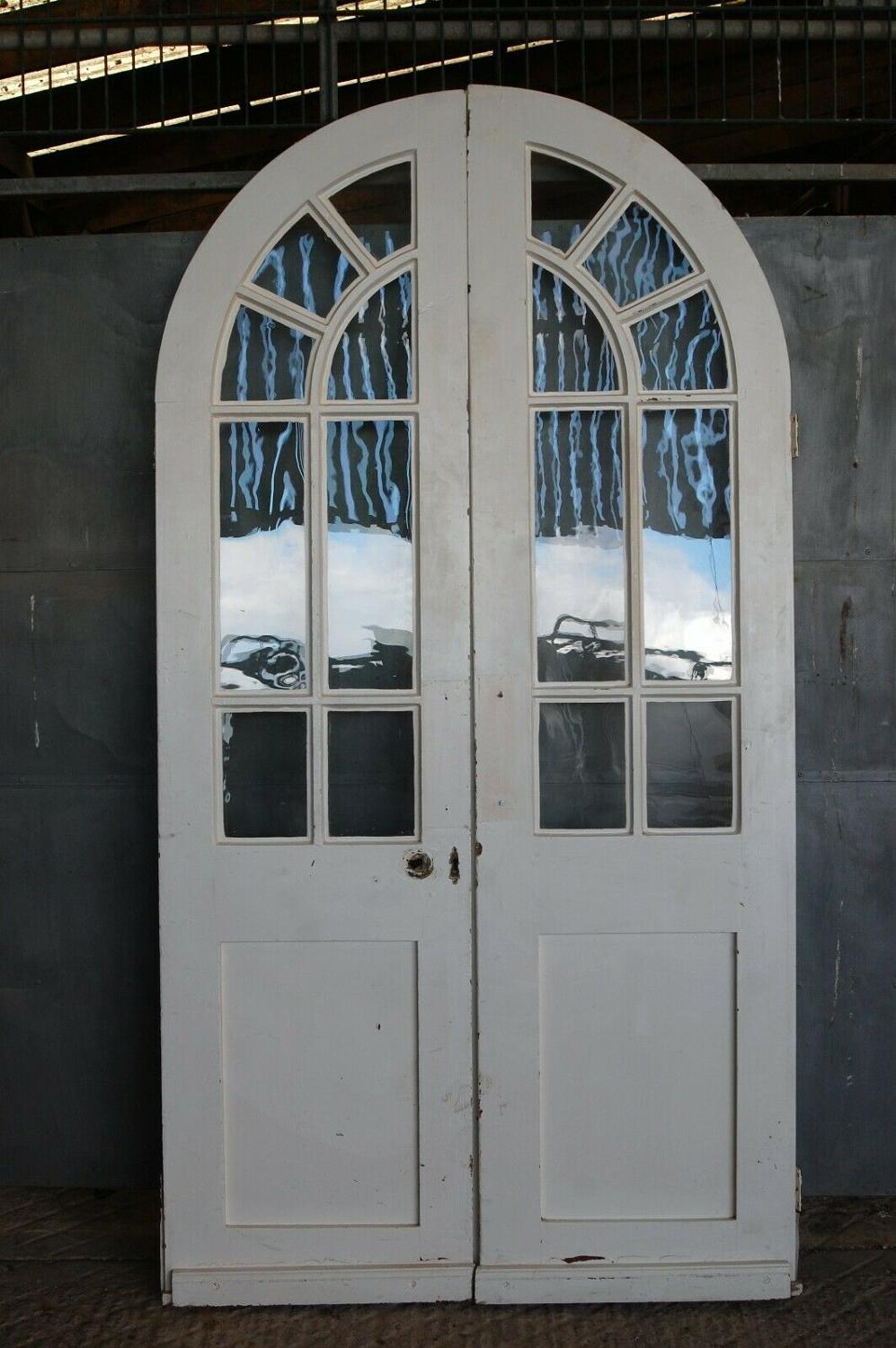 DP0266 A PAIR OF RECLAIMED ANTIQUE GLAZED ARCHED PAINTED DOORS