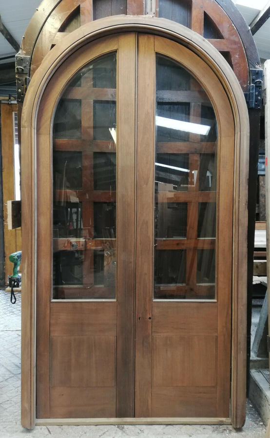 DP0275 PAIR OF SUBSTANTIAL ARCHED GLAZED MAHOGANY DOORS AND FRAME