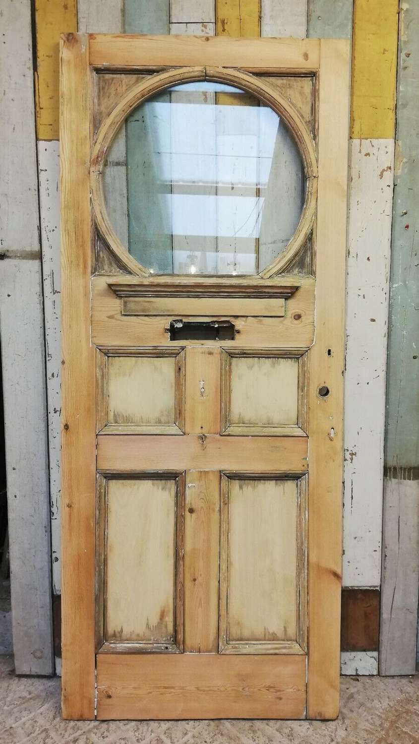 DE0820 A STRIPPED PINE EDWARIDAN FRONT DOOR WITH LARGE GLAZED PANEL