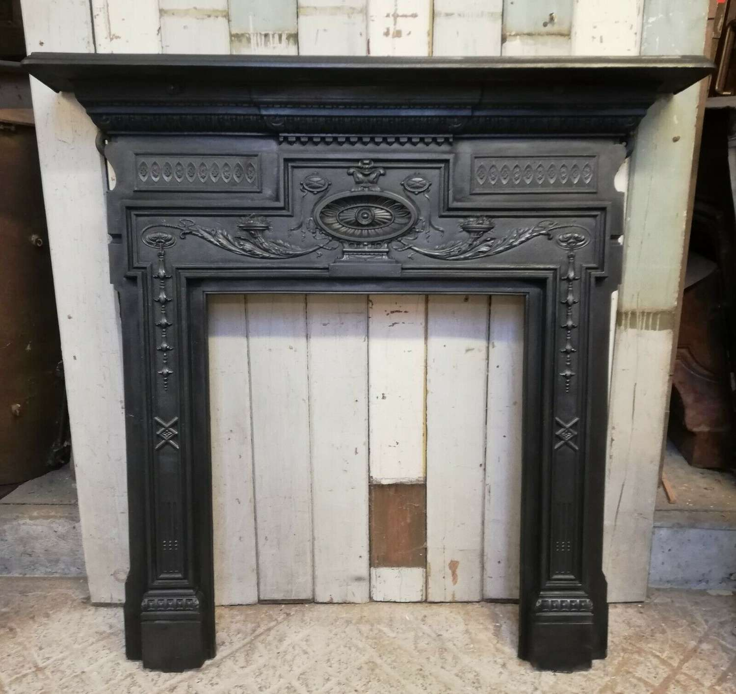 FS0085 AN ORNATE VICTORIAN CAST IRON FIRE SURROUND FOR WOOD BURNER