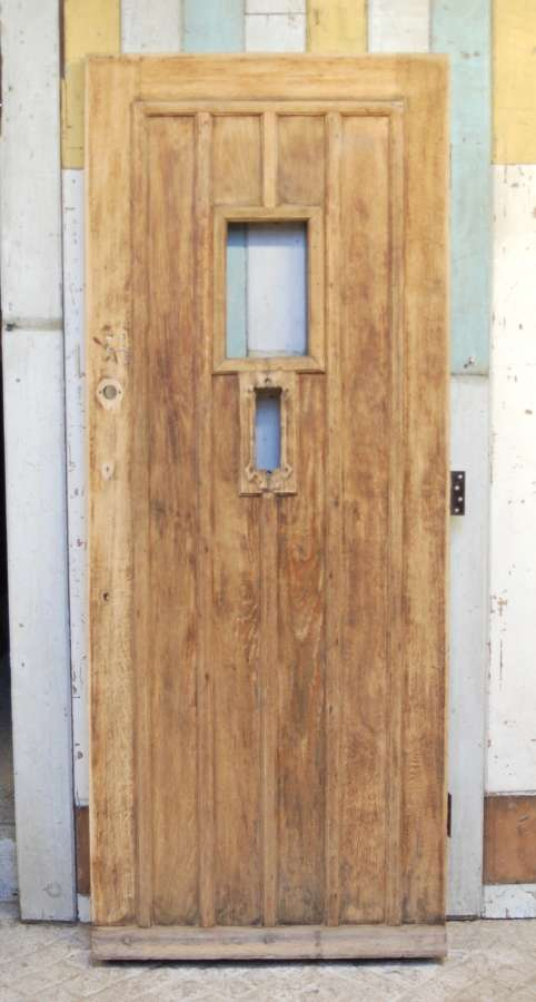 DE0825 A RECLAIMED BARE OAK FRONT DOOR WITH PANEL FOR GLAZING