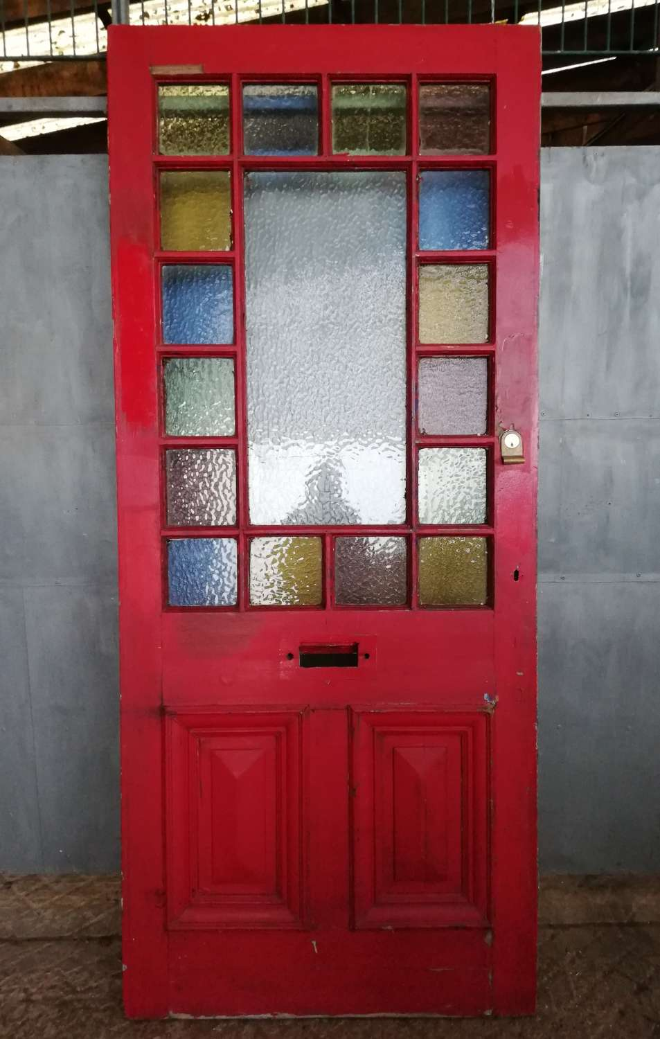 DE0837 A RECLAIMED PINE FRONT DOOR WITH COLOURED GLASS