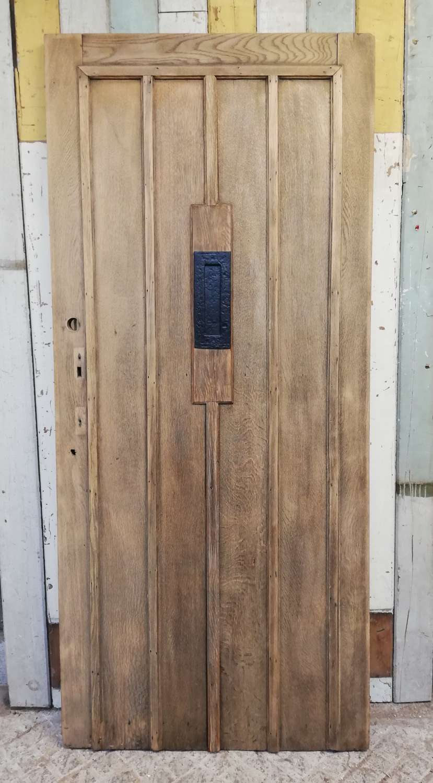 DE0833 A RECLAIMED BARE OAK COTTAGE STYLE FRONT DOOR