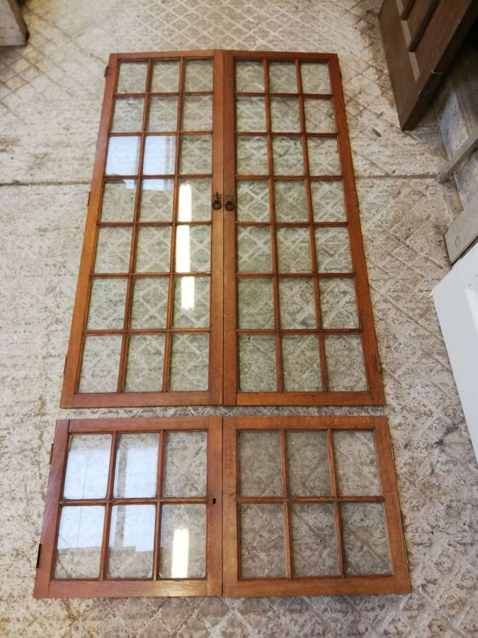 CS0031 A SET OF 8 RECLAIMED OAK AND GLASS CUPBOARD DOORS