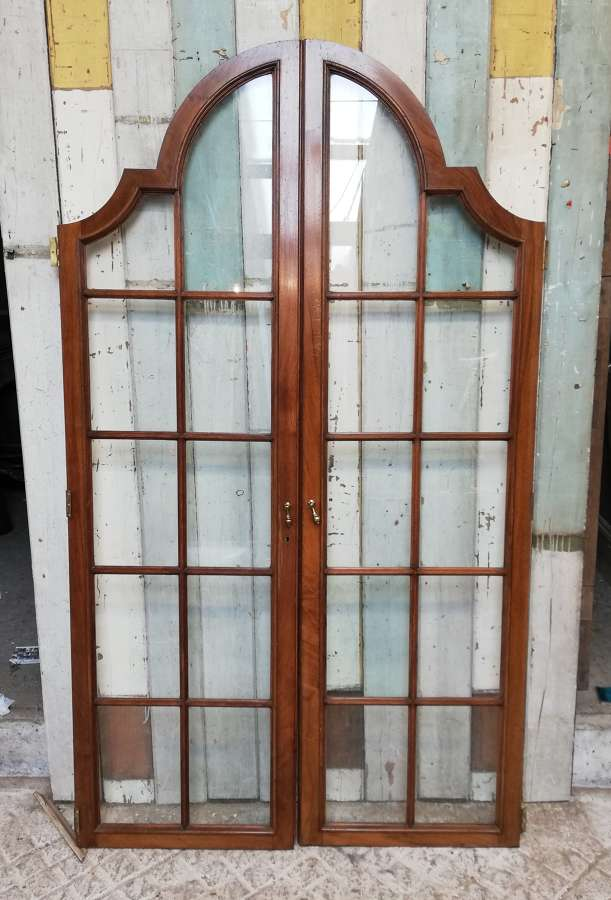 CS0030 SET OF 4 RECLAIMED ARCHED MAHOGANY AND GLASS CUPBOARD DOORS