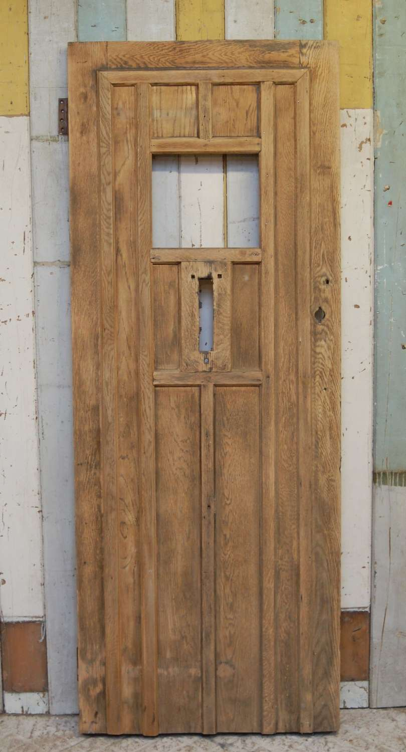 DE0846 A RECLAIMED BARE OAK FRONT DOOR WITH PANEL FOR GLAZING