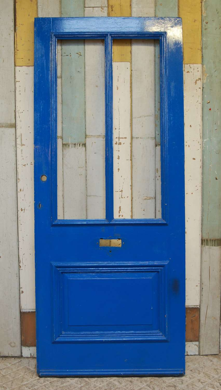 DE0844 A LATE VICTORIAN PAINTED PINE FRONT DOOR