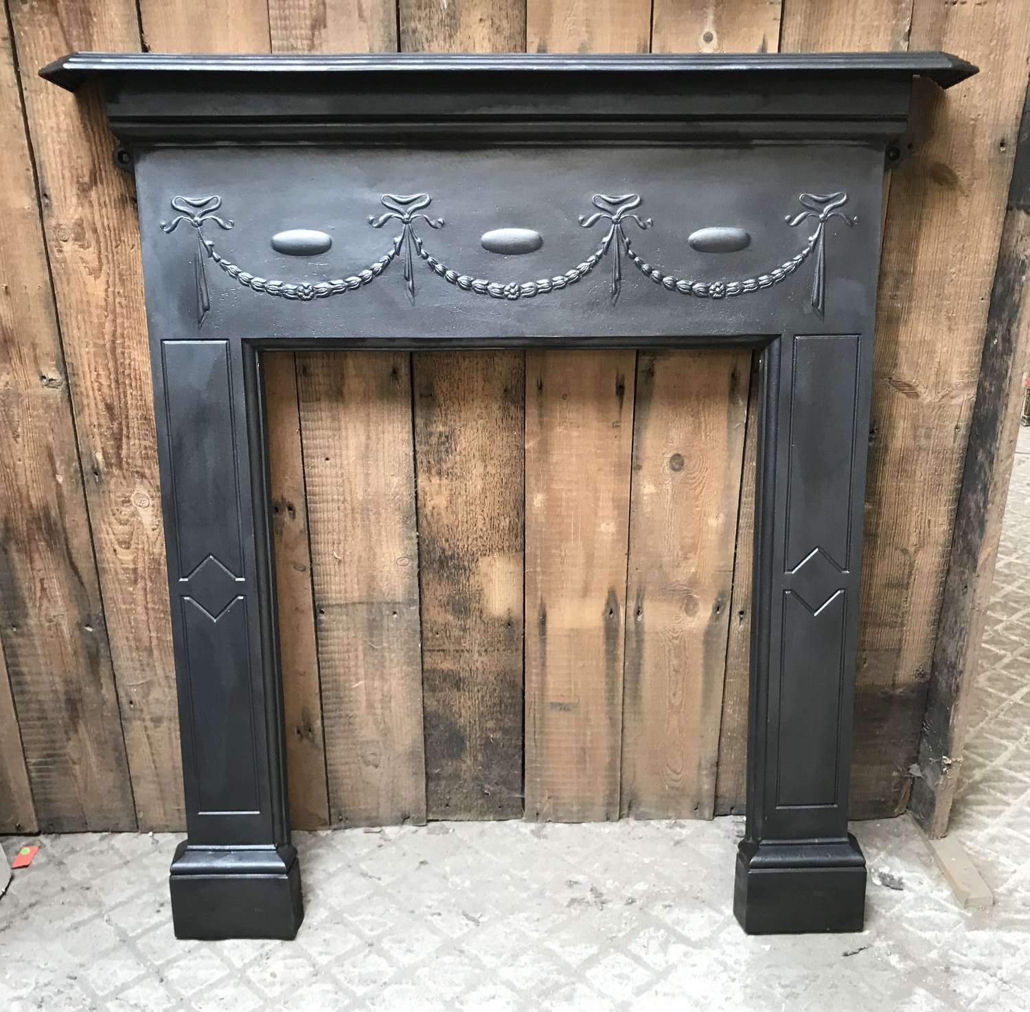 FS0112 A RECLAIMED EDWARDIAN CAST IRON FIRE SURROUND FOR WOOD BURNER