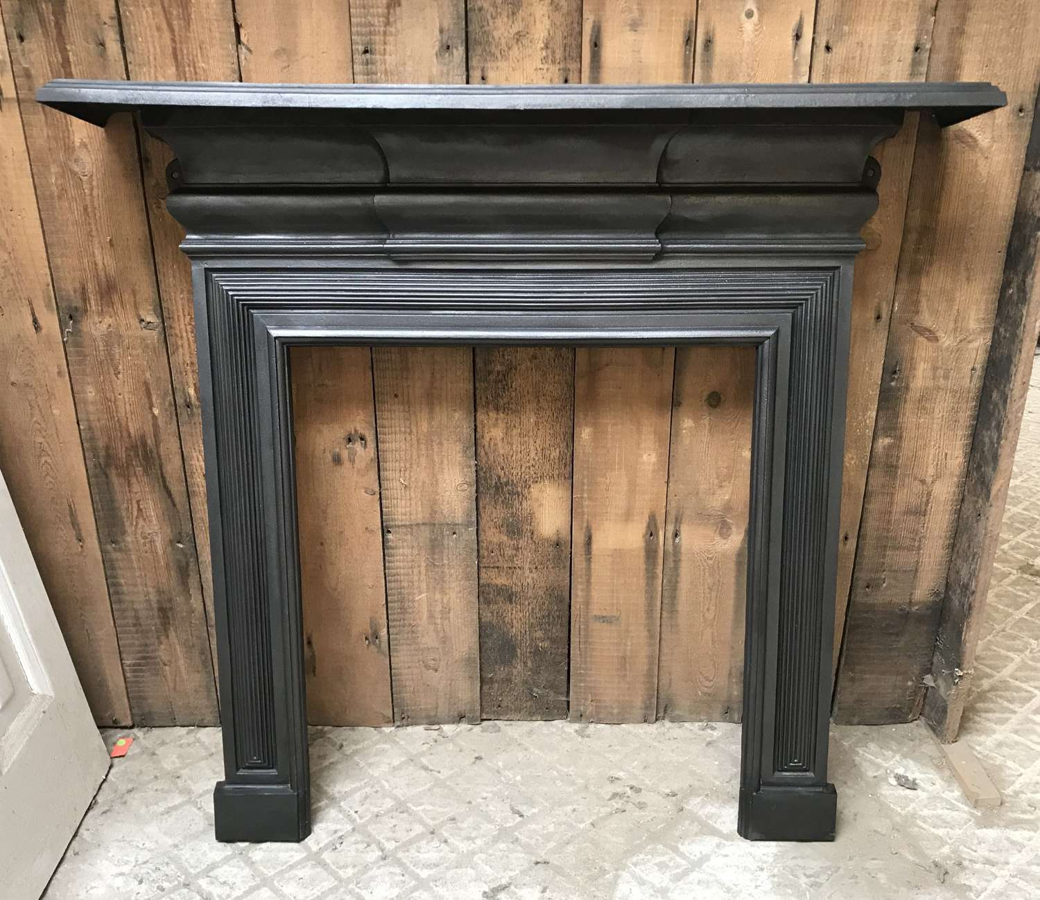 FS0110 A RECLAIMED EDWARDIAN CAST IRON FIRE SURROUND FOR WOODBURNER
