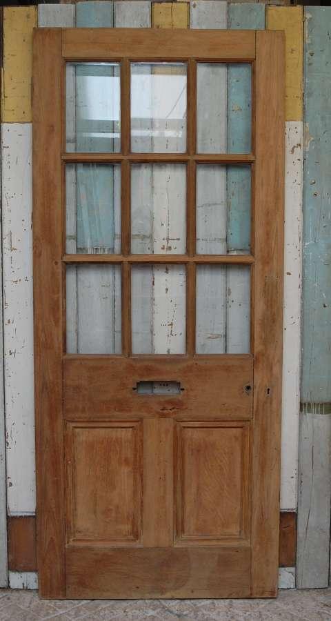 DE0851 A RECLAIMED TEAK EXTERNAL DOOR WITH GLAZED PANELS